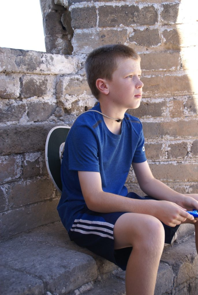 Logan enjoying a quiet moment on the Great Wall of China