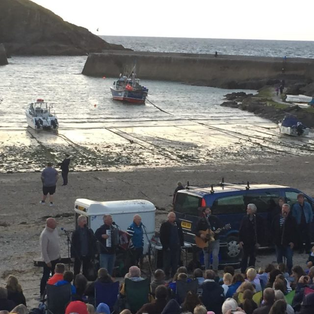 Watching the fantastic Fishermans Friends on the beach at Porthellip