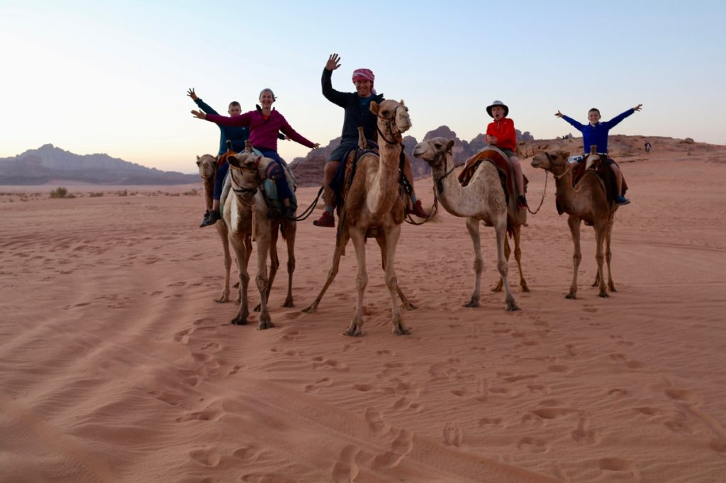Camel riding with kids in Wadi Rum Jordan