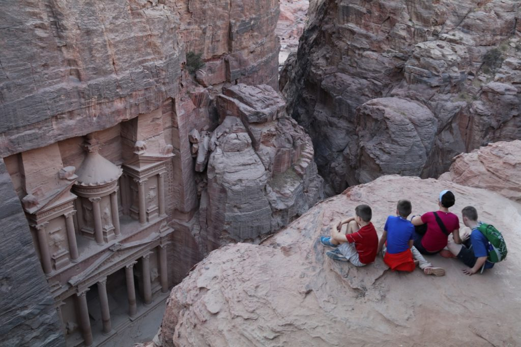Looking down on the Treasury at Petra with kids!